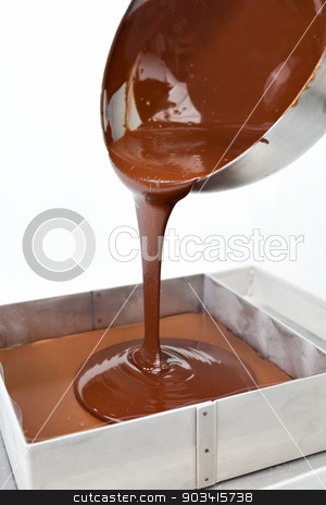 Dripping chocolate stock photo, Chocolate in melt and drips down a metal bowl  by Dario Rota