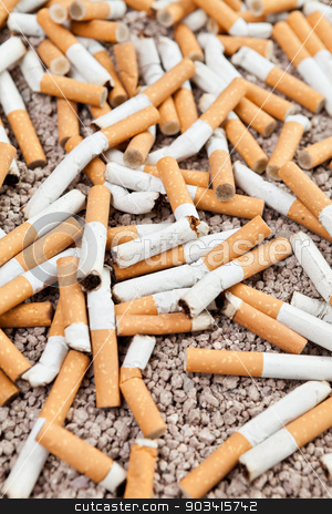 Fallen cigarettes chaos stock photo, Ashtray full of smoked fallen cigarettes in the sand  by Dario Rota