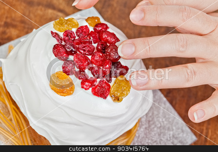 Hands decorating christmas cake stock photo, Christmas creamy cake decorated by hands  by Dario Rota