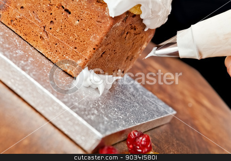 Pastry bag decoration stock photo, Decorating christmas cake with a pastry bag  by Dario Rota