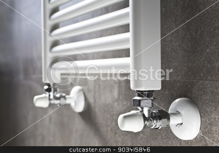 Bathroom heater closeup stock photo, White bathroom heater closeup on gray wall  by Dario Rota