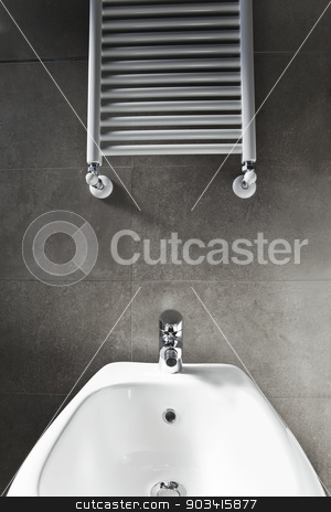 Bidet and heater stock photo, White porcelain bidet and heater  by Dario Rota