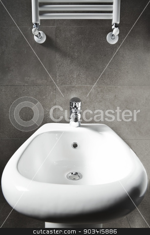 Bidet entire and heater stock photo, White porcelain entire bidet and heater by Dario Rota