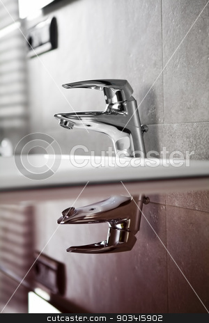 Bathroom faucet sefletion symmetrical stock photo, Bathroom faucet reflection on red board by Dario Rota