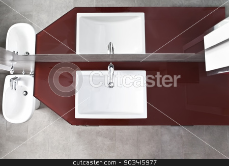 Sink and bidet view from above stock photo, Bathroom sink, bidet and mirror reflection from above by Dario Rota