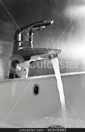 Sink closeup splash backlight stock photo, Bathroom sink silhouette lighted by backlight with water splash by Dario Rota