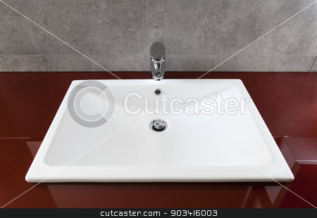 White bathroom sink stock photo, White bathroom sink on a red translucent board  by Dario Rota