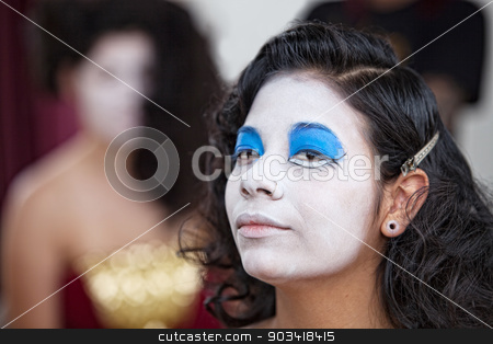Confident Female Circus Performer stock photo, Serious young female cirque performer with white facepaint by Scott Griessel