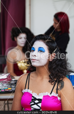 Performer in White Makeup stock photo, Cute young Hispanic cirque performer with white makeup by Scott Griessel