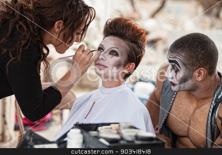Makeup Artist Working Backstage stock photo, Male clown looking at woman getting makeup backstage by Scott Griessel
