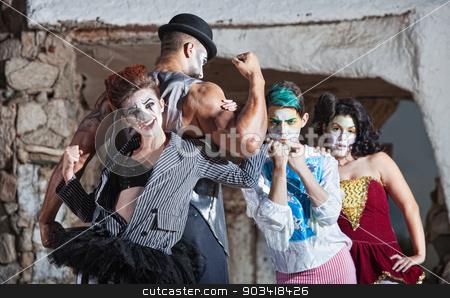 Bizarre Cirque Performance stock photo, Bizarre comedia del arte performance ensemble outdoors by Scott Griessel