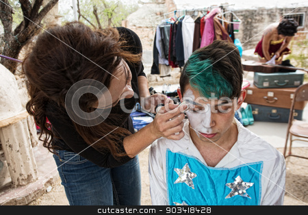 Clown Getting Makeup stock photo, Female makeup artist putting makeup on male clown by Scott Griessel