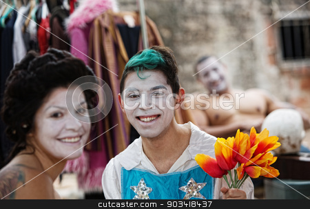Happy Clown Friends stock photo, Group of happy young adult clowns smiling backstage by Scott Griessel