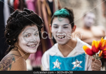 Cheerful Female Clown stock photo, Cheerful Latino female cirque clown laughing with friend by Scott Griessel