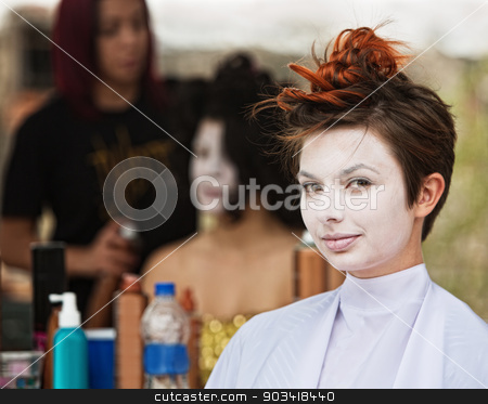 Calm Woman in White Makeup stock photo, Young female actress in white make up sitting by Scott Griessel