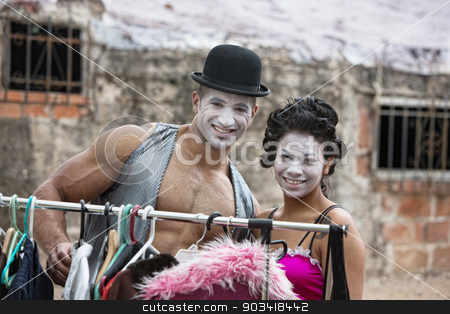 Attractive Cirque Clowns stock photo, Handsome clown with muscles and hat with partner by Scott Griessel