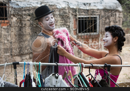 Cirque Clowns Fitting Costumes stock photo, Two laughing cirque clowns fitting costumes outdoors by Scott Griessel