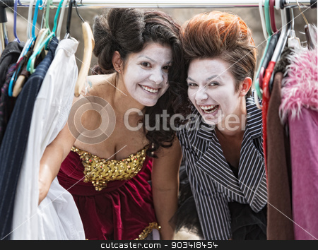 Laughing Clowns at Clothes Rack stock photo, Comedia Del Arte actors laughing at clothing rack by Scott Griessel