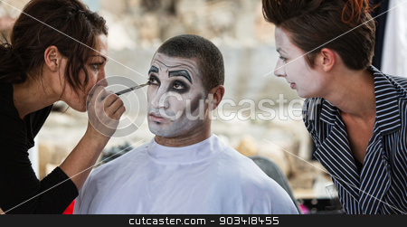 Clown Getting Eye Shadow stock photo, Handsome male clown with stylist putting on eye shadow by Scott Griessel