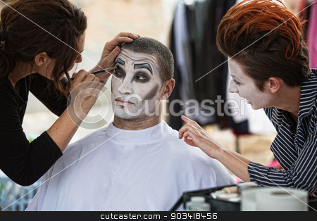 Cirque Clowns Backstage Makeup stock photo, Group of clowns backstage with make up artist by Scott Griessel