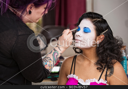 Pretty Clown Getting Eye Shadow stock photo, Young beautiful clown getting eye shadow backstage by Scott Griessel