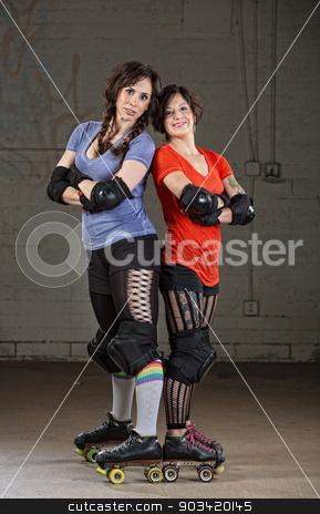 Confident Roller Derby Skaters stock photo, Pair of confident female roller skaters derby standing by Scott Griessel