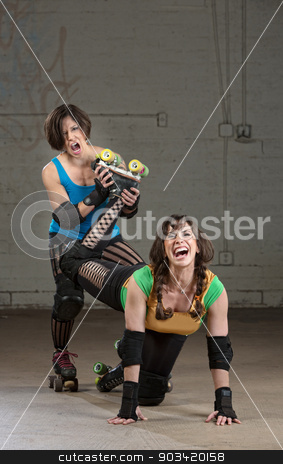 Roller Derby Bully stock photo, Bully roller derby skater twisting the leg of a woman by Scott Griessel