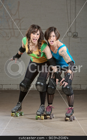 Aggressive Roller Derby Skaters stock photo, Aggressive women roller derby skaters threatening with a pose by Scott Griessel