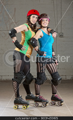 Female Roller Derby Skaters stock photo, Pair of roller derby skater friends with helmets by Scott Griessel