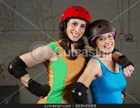 Happy Roller Derby Friends stock photo, Pair of happy adult roller derby friends by Scott Griessel