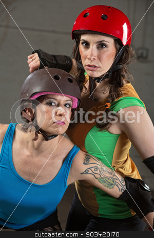 Beautiful and Tough Roller Derby Skaters stock photo, Two beautiful tough roller derby skaters with helmets by Scott Griessel
