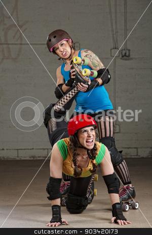 Female Twisting Roller Derby Skater's Leg stock photo, Hostile roller derby skater attacking woman with leg twist by Scott Griessel