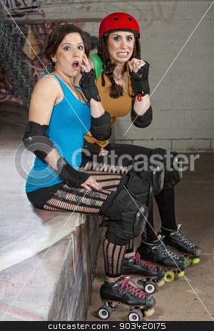 Startled Roller Derby Women stock photo, Startled pretty women sitting at roller derby by Scott Griessel