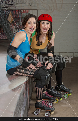 Laughing Female Roller Derby Skaters stock photo, Ladies at roller derby as spectators laughing  by Scott Griessel
