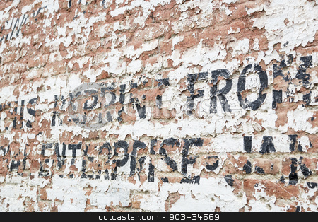 Old Weathered Brick Wall with Advertisement stock photo, Old Weathered Brick Wall with Decaying Advertisement Writing. by Andy Dean