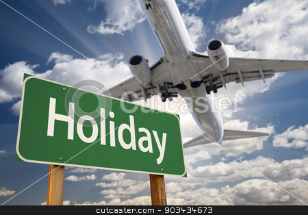 Holiday Green Road Sign and Airplane Above stock photo, Holiday Green Road Sign and Airplane Above with Dramatic Blue Sky and Clouds. by Andy Dean