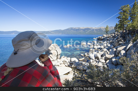 Woman Looking Over Beautiful Shoreline of Lake Tahoe. stock photo, Woman Looking Over Beautiful Clear Water Shoreline of Lake Tahoe. by Andy Dean