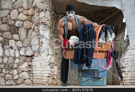 Bizarre Comedy Performer stock photo, Serious single male bizarre comedy performer next to luggage by Scott Griessel
