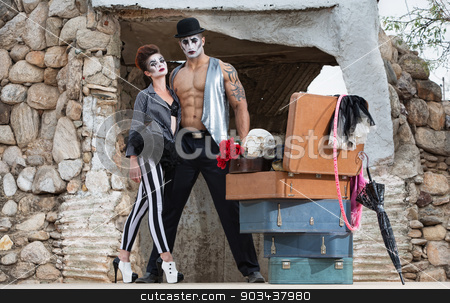 Bizarre Circus Performers stock photo, Muscular cirque performer with bizarre female partner in striped pants by Scott Griessel