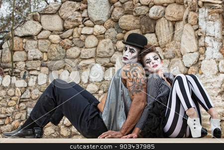 Clowns Sitting Back to Back stock photo, Serious comedy del arte performers sitting back to back by Scott Griessel