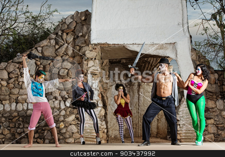Surreal Cirque Stage Combat stock photo, Comedia del arte ensemble in stage combat outdoors by Scott Griessel