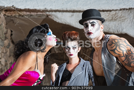 Jealous Cirque Clown stock photo, Jealous cirque performer in love triangle on stage by Scott Griessel
