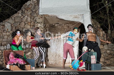 Comedy Actors Tug-Of-War stock photo, Group of silly cirque clowns playing tug-of-war by Scott Griessel