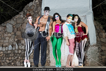 Comedia Del Arte Clowns stock photo, Group of comedia del arte clowns on stage by Scott Griessel