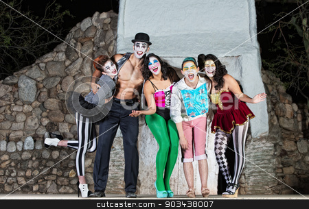 Laughing Surreal Clowns stock photo, Group of surreal clowns on stage laughing by Scott Griessel