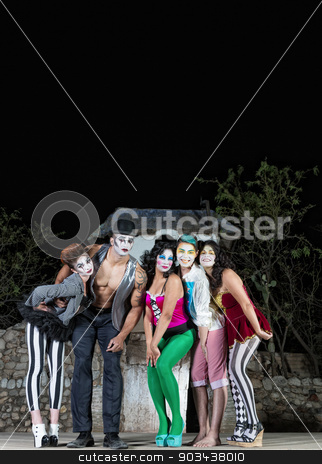 Clown Ensemble on Stage stock photo, Clown ensemble posing on outdoor theater stage by Scott Griessel