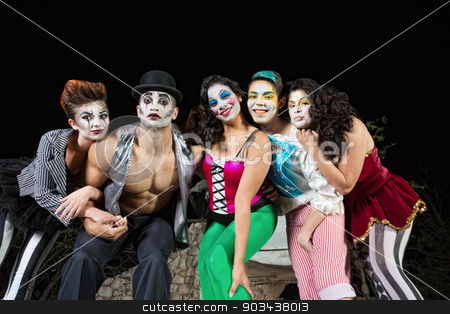 Clowns on Stage stock photo, Group of character clowns posing on stage by Scott Griessel