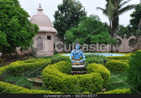 Statue of Hindu Lord Krishna stock photo, Statue of Hindu Lord Krishna at Shree Swaminarayan Gurukul in Hyderabad, India by Ritu Jethani