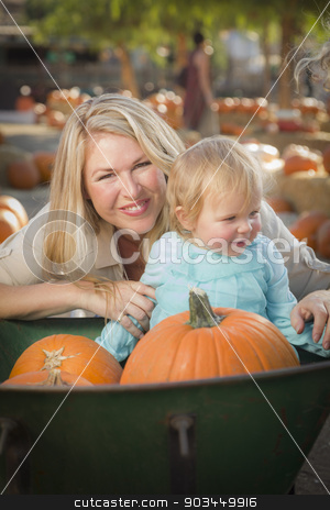 Young Mother and Daughter Enjoys the Pumpkin Patch stock photo, Adorable Young Mother and Daughter Enjoys a Day at the Pumpkin Patch. by Andy Dean