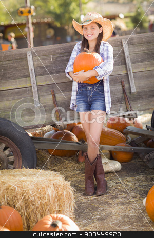 Pretty Preteen Girl Portrait at the Pumpkin Patch stock photo, Preteen Girl Wearing Cowboy Hat Portrait at the Pumpkin Patch in a Rustic Setting. by Andy Dean